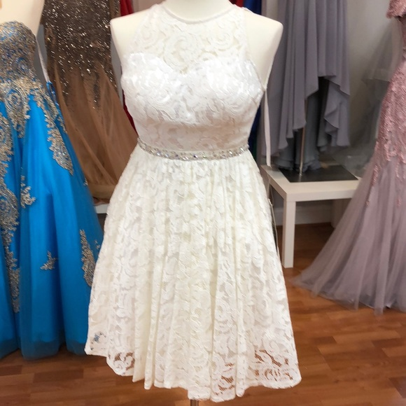 25c2fe7967f White graduation dress with rhinestone waist. Boutique
